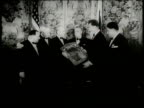 Newsreel / Narrated / Herbert Hoover is celebrated by crowds at various locations / Secretary of the Treasure Tom Snyder awards Herbert Hoover with...