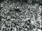 Newsreel / Narrated / Hundreds of fans crowd the street below Dean Martin and Jerry Lewis' Times Square dressing rooms / Jerry Lewis and Dean Martin...