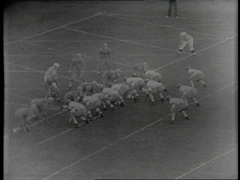 Newsreel / Narrated / Paramount News / College Football Northwestern vs Minnesota in Evanston Illinois / Continued highlights from the game / 3rd...