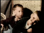 Newsreel / Narrated / Polio vaccine creates new hope for public health in 1955 / Magnified image of the virus Polio / Some children that are infected...