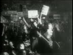 Newsreel / Narrated / United Automobile Workers pick their new President / members wave signs to support their candidates / R J Thomas and Walter P...