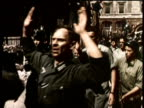 Newsreel / Narrated / World War 2 / French citizens cheer as soldiers and civilians successfully remove the Nazi presence in Paris France in 1944...