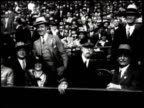 Newsreel / New York Yankees beat the Pittsburgh Pirates / Shot of a crowded stadium / crowd rises and sits back down / two uniformed players stand in...
