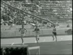 Newsreel / No Audio / Pathe News / Title card 3000 Meter Steeplechase Won By IsoHollo Finland No 117 Time 1033 4 / Pan shot of runners leave the...