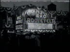 Newsreel / No audio/ The marquee of the RKO Roosevelt in Harlem advertises it's opening night including appearances by Bill Robinson and Fredi...