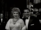 Newsreel / No Audio / The stars line up on the red carpet for the premiere of the 1954 film A Star Is Born / Lucille Ball and Desi Arnaz smile at the...