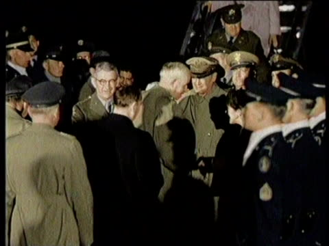Newsreel / No Audio / Truman Fires MacArthur for conflicting statements in 1951 / MacArthur and family in a car for a ticker tape parade on a...