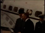 Newsreel / No audio / World War 2 / Adolf Hitler in a room greeting and shaking hands with officials / Hitler and officials signing the Munich pact /...