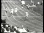 Newsreel / Olympic Track and Field / 400M Hurdles / American Roy Cochran leads and wins Gold he shatters the Olympic record / Women's 100M Dash...