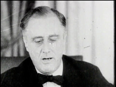 Newsreel / Pathe News / Franklin D Roosevelt receives democratic nomination for presidency in 1932 / Roosevelt playing with children / writing with...