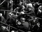 Newsreel / President Roosevelt delivers speech defending his farm policy / crowd and staff cheer at the end of the speech /