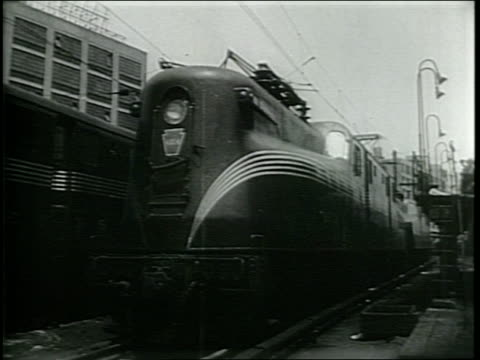 Newsreel / Railroad Labor Crisis / Steam Engine Train / Footage during the Railway Strike stationary freight and passenger trains across the US /...