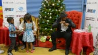 NeYo and Angela Simmons Visit Boys Girls Clubs of MiamiDade for The Compound Foundation's Annual Holiday Giving Tour which in partnership with Boys...