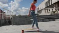 Nice woman riding skateboard outdoors