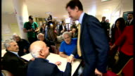 Nick Clegg interview and visit to Cypriot Community Centre Clegg chatting with Cypriot pensioners at table SOT / Photographers taking pictures /...