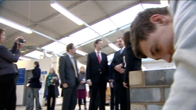 Nick Clegg meets apprentices in Cambridge ENGLAND Cambridgeshire Cambridge EXT Nick Clegg MP arriving and shaking hands with staff members...