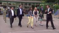 Nick Clegg Miriam Durantez visit Ivy Lane School in Chippenham Shows exterior shots Nick Clegg Miriam Durantez walking across the school playground...