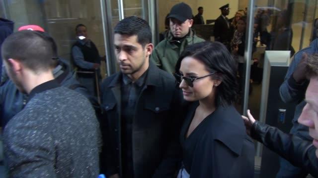 Nick Jonas Demi Lovato and Wilmer Valderrama leaving SiriusXM Satellite Radio in New York City on October 26 2015 in New York City
