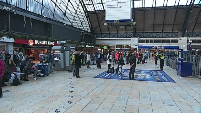 Nicola Sturgeon and Glasgow silences Police and guards in Glasgow Queen Street Station / Passengers stand for minute silence / Passengers in Glasgow...