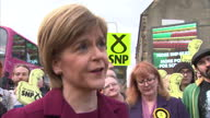 Nicola Sturgeon launches SNPs final poster Shows exterior shots Nicola Sturgeon denounces people involved in negative tactics how she will continue...