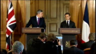 press conference with Gordon Brown ENGLAND London Downing Street INT Gordon Brown MP and Nicolas Sarkozy along into room to stand at podiums Gordon...