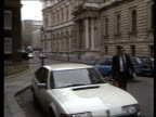 Nigel Lawson gives Autumn Statement MS Patrick Jenkin Environment Sec from car into No 10