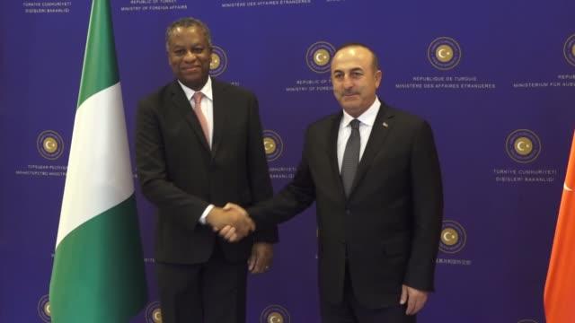 Nigerian Foreign Minister Geoffrey Onyeama meets with Turkish Foreign Minister Mevlut Cavusoglu in Ankara Turkey on October 18 2017