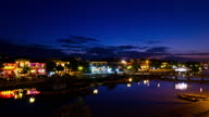 Night falling across Hoi An ancient town and the Thu Bon river, Vietnam