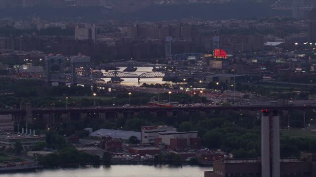 Night flight along East River, looking across Randalls Island. Shot in 2006.