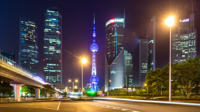 night scene of city road and modern buildings in shanghai time lapse 4k