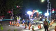 night scene of road repair constructions site in tokyo at night.