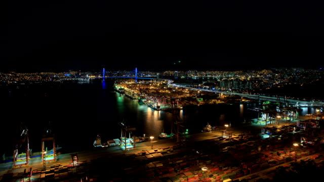 Night scenery of Busan Harbor and a large bridge