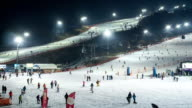 Night scenery of large group of people and ski lift at the ski resort