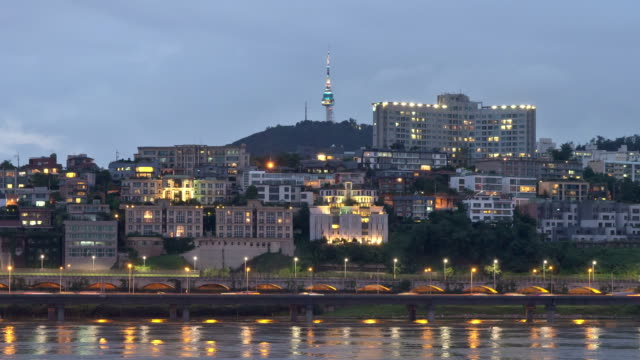 Night scenery of the N Seoul Tower and traffic moving on Gangbyeonbungno(Riverside Expressway)