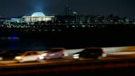 Night scenery of traffic moving on Gangbyeonbungno highway and houses of parliament over the Han river