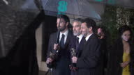 Night shot Grant Heslov Ben Affleck and George Clooney posing with BAFTA Award British Academy Film Awards at The Royal Opera House on February 10...
