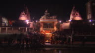 Night shot of a Hindu ceremony taking place on the banks of the Ganges in the town of Devprayag.