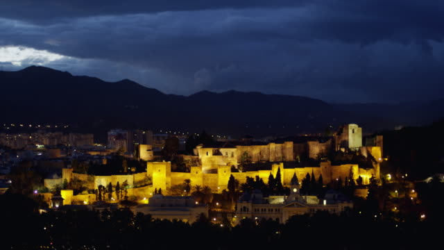 WS night shot of the Alcazaba (old Moorish castle and fortress) complex; started 8th century, mostly built during 11th century / Malaga, Andalusia, Spain