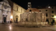 Night shot of the big Onofrio's fountain decorated with 16 drinking panels, Dubrovnik
