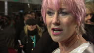 Night shots Dame Helen Mirren on red carpet talking to press British Academy Film Awards at The Royal Opera House on February 10 2013 in London...