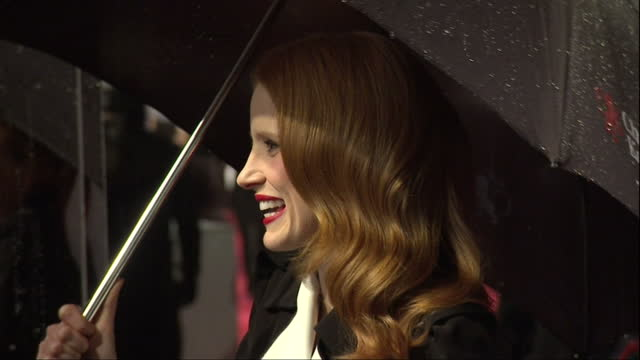 Night shots Jessica Chastain chatting to press on red carpet British Academy Film Awards at The Royal Opera House on February 10 2013 in London...