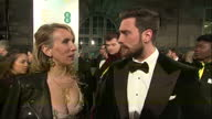 Night shots of actor Aaron Taylor Johnson and his wife Sam Taylor Johnson talking about working on the film Nocturnal Animals on February 12 2017 in...