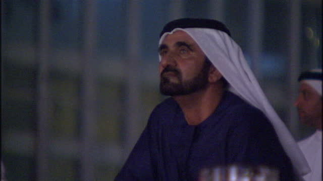 Night shots of His Highness Sheikh Mohammed Bin Rashid Al Maktoum watching a performance for the official opening of the Dubai Mall His Highness...