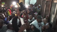 Night shots of Pastor Evan Mawarire cheering celebrating outside court house after finding out about his release on July 13 2016 in Harare Zimbabwe A...