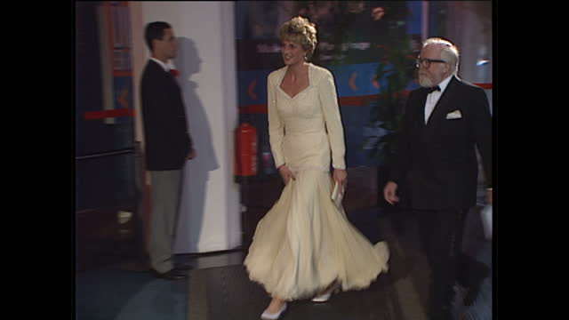 Night shots of Princess Diana arriving at the National Film Theatre with Sir Richard Attenborough for the BFI awards ceremony Princess Diana wears a...