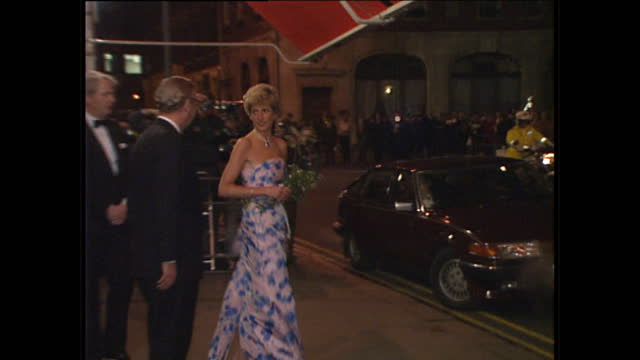 Night shots of Princess Diana departing the Royal Opera House after watching a performance of Romeo Juliet in Covent Garden Princess Diana wears a...
