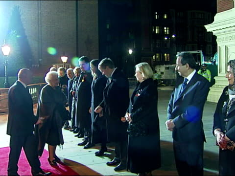 Night shots of Queen Elizabeth II meeting guests on the red carpet at the Festival of Remembrance at the Royal Albert Hall The Queen Attends the...