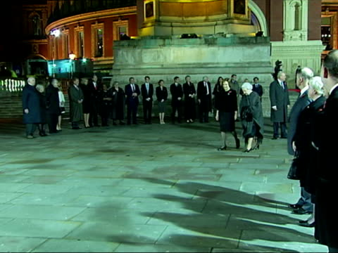 Night shots of Queen Elizabeth II viewing a plaque commemorating the renaming of the Royal Albert Hall's South Steps as the Queen Elizabeth II...