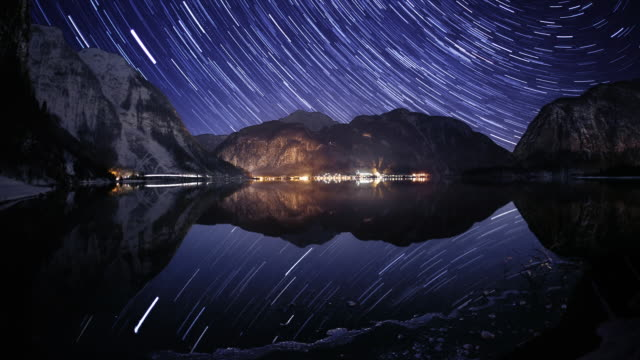 Night sky and star trails above Hallstatt