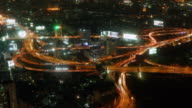 Night Time lapse Aerial view of rush hour traffic on expressway